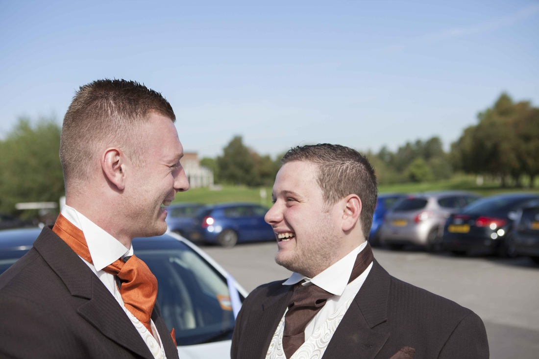 Dewi and best man laughing