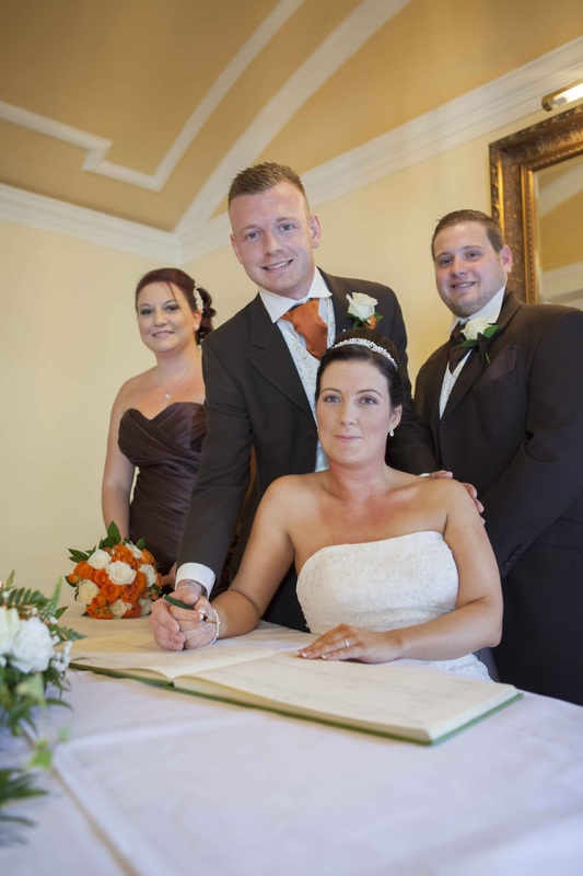 Dewi and Gemma signing the register